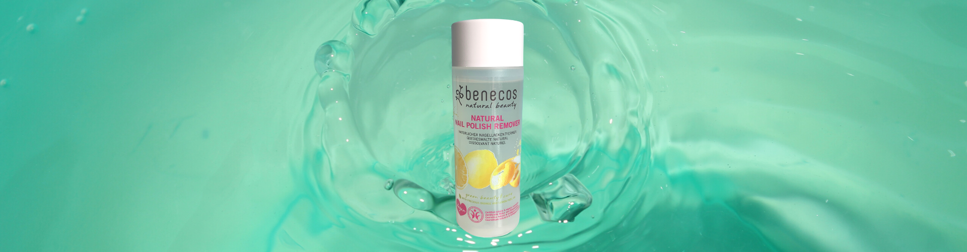 Photo of a bottle of Benecos nail polish remover over a water background