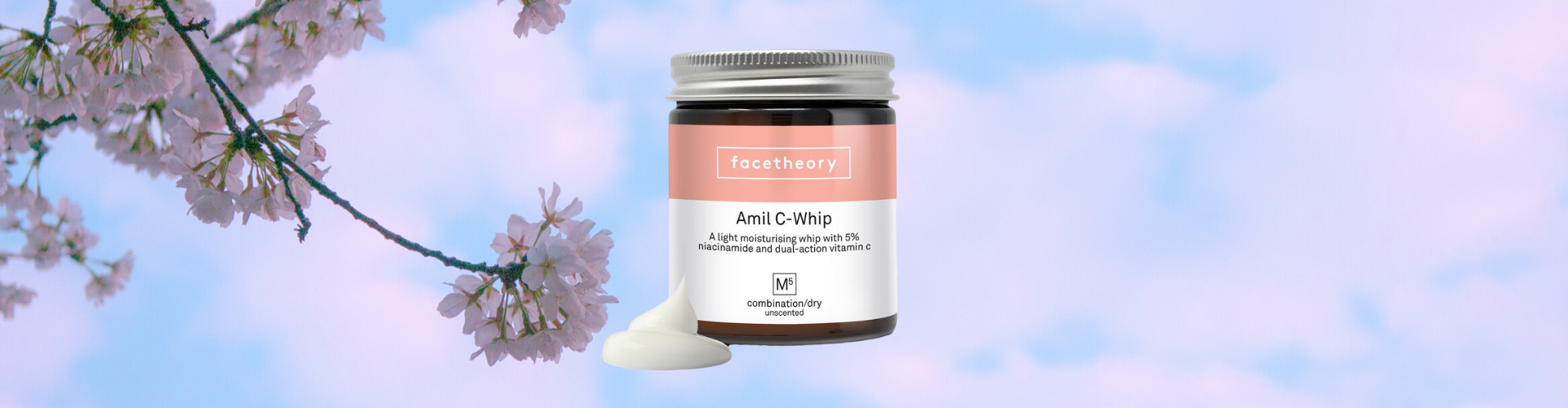 Facetheory amil-c whip review - photo of the moisturiser with a cherry blossom background.