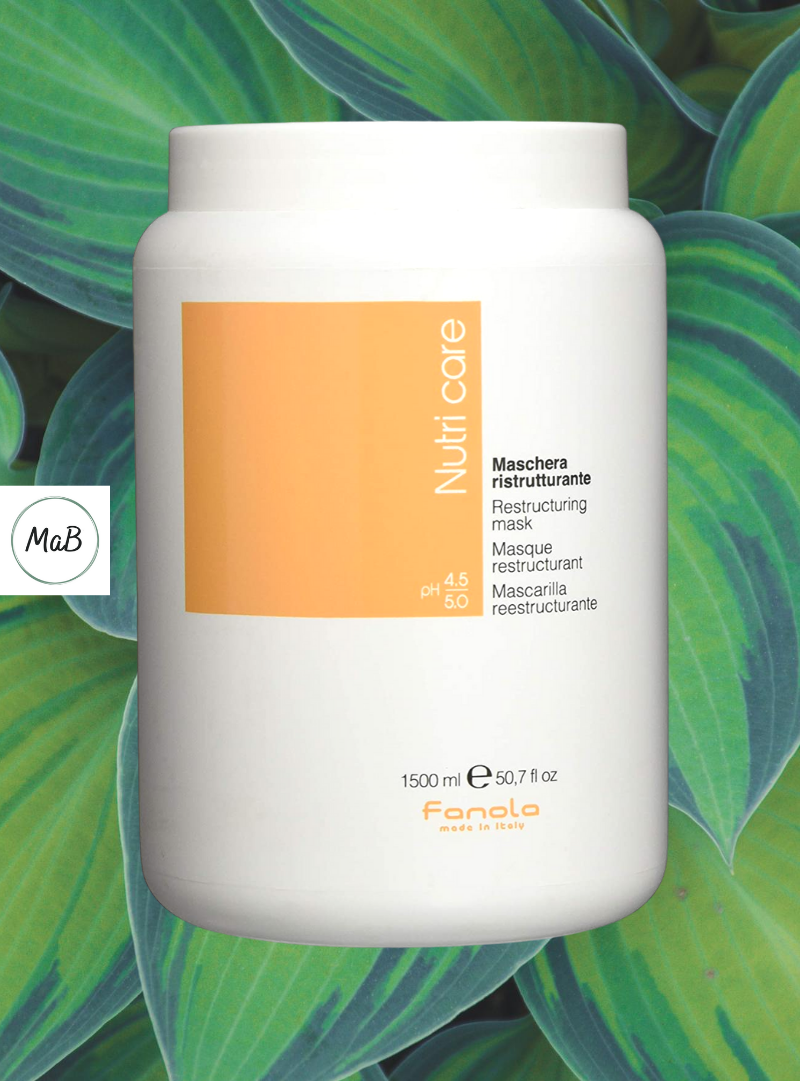 A photograph of a tub of fanola nutricare hair mask with hosta leaves in the background