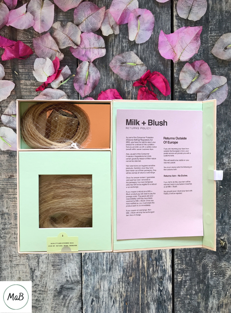 A photo of a box with Milk and Blush hair extensions inside.