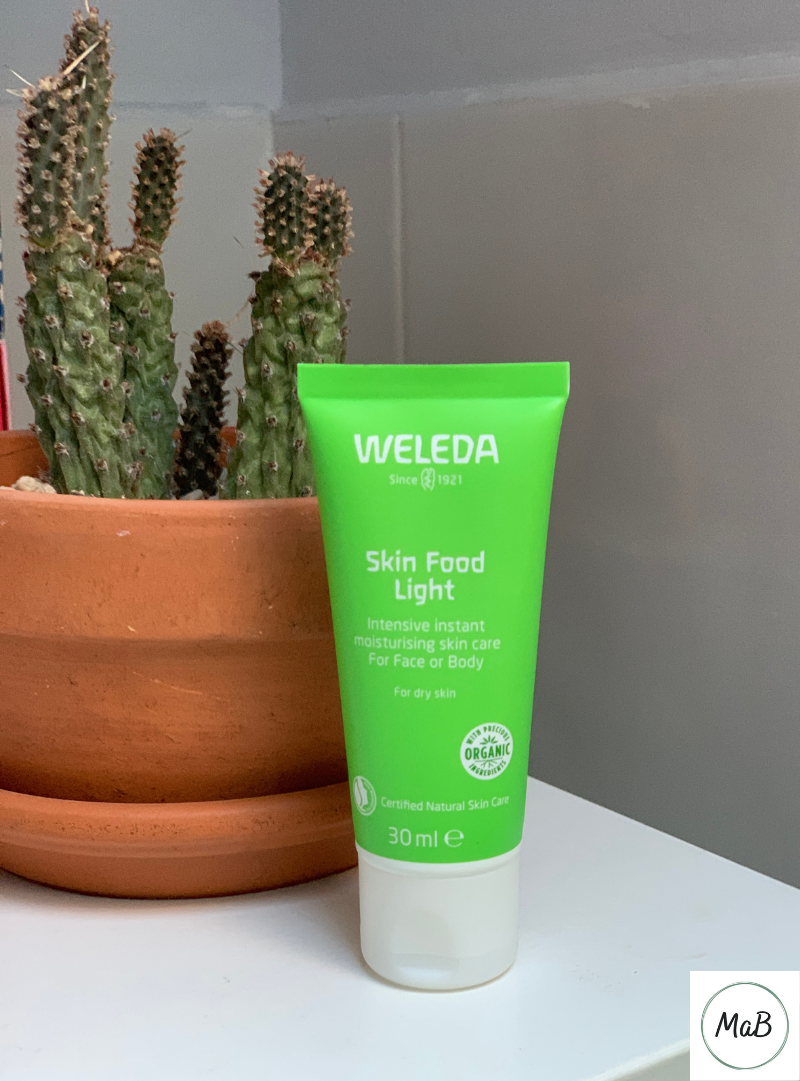 A photograph of a tube of Weleda Skin Food on a bathroom cabinet.