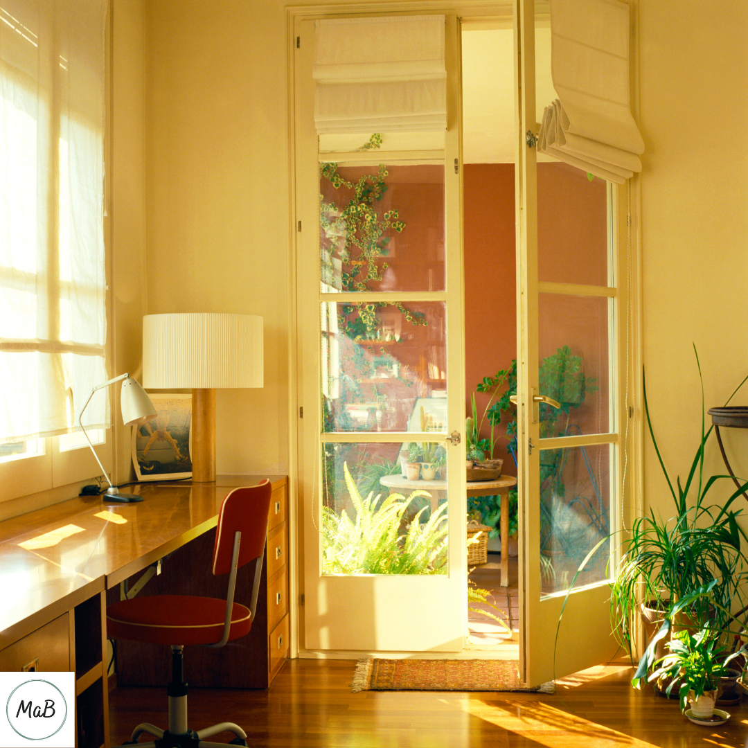 Working from home tips - a photograph of a home office with the door slightly ajar.